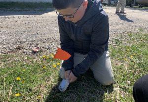 Multi-Age Student Planting Pumpkin Seeds